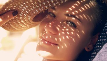 hat shadown on woman's face